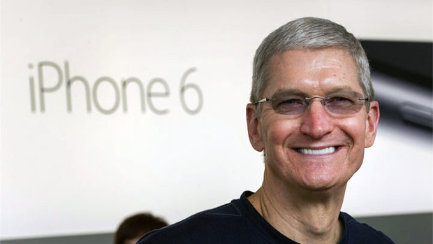 Apple CEO Tim Cook celebrated another incredible quarter with Apple, thanks to the iPhone 6 setting sales records. [Image Source: Bloomberg]
